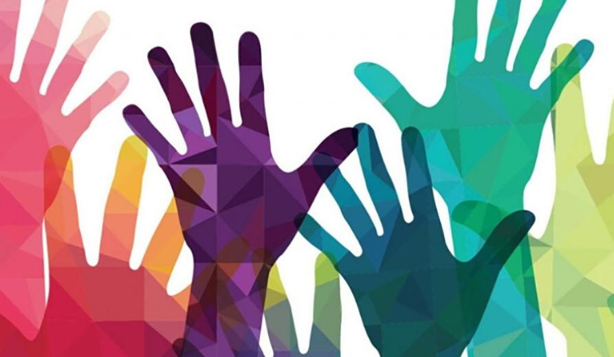 Image from Education for Social Justice Framework – colourful hands raised.