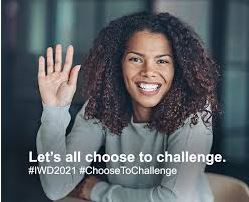 Image shows a woman holding up her hand with the text Let's all choose to challenge